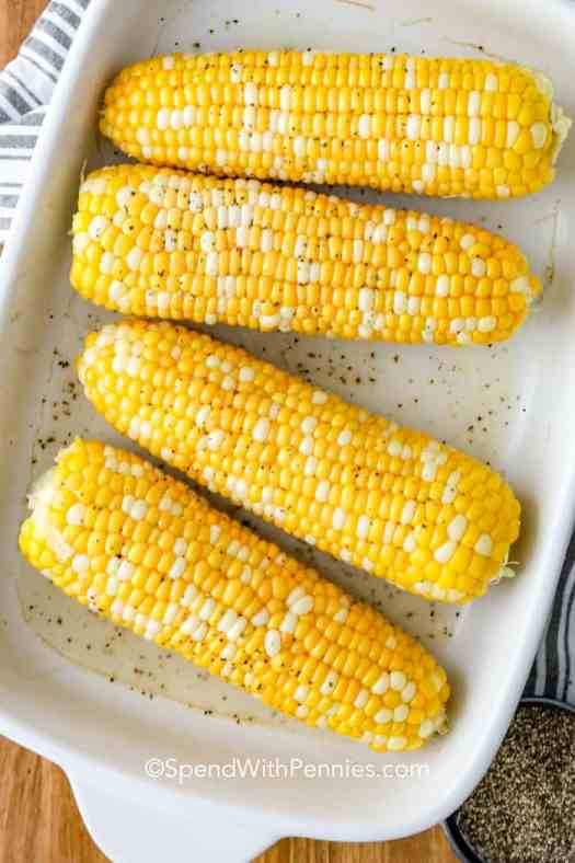 Baked corn on the cob in a baking tray.