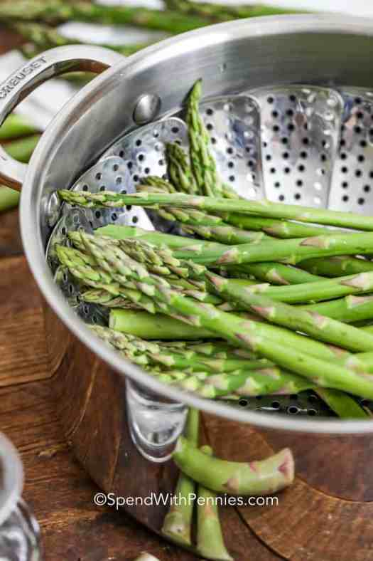 Close up of asparagus in a steaming basket.