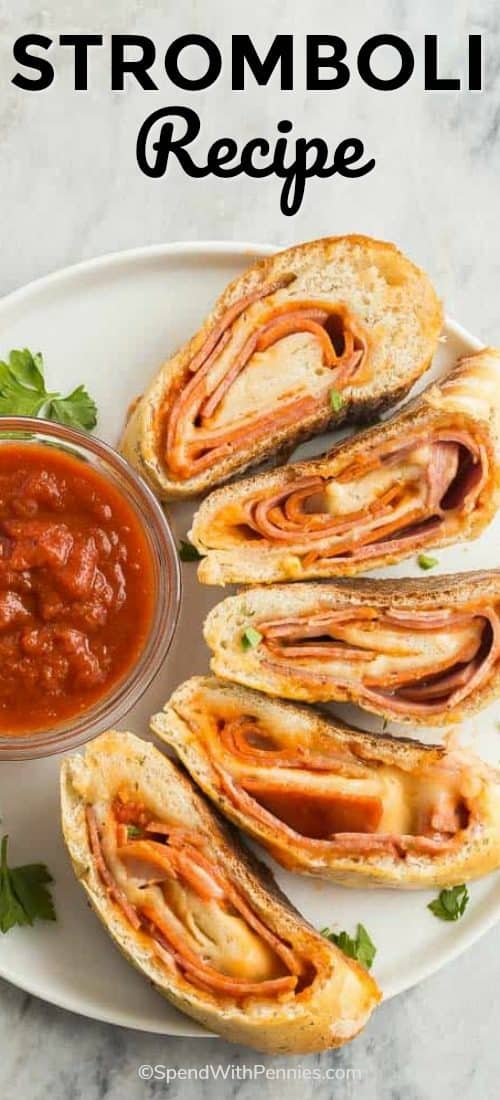 Slices from this simple Stromboli Recipe sitting on a white plate and surrounding a clear bowl of salsa