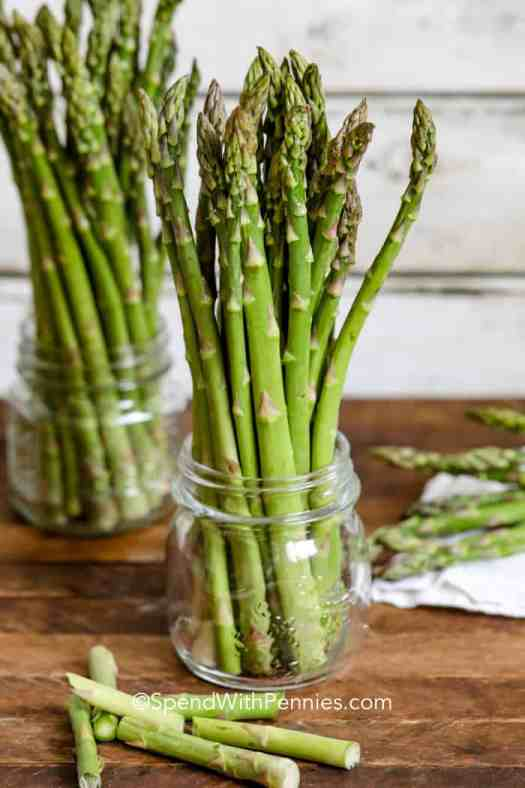 Asparagus prepared and ready to store in the fridge in a glass jar