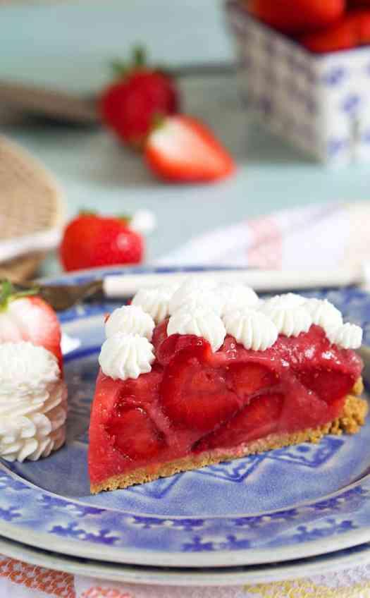 A slice of No Bake Strawberry Pie on a plate.
