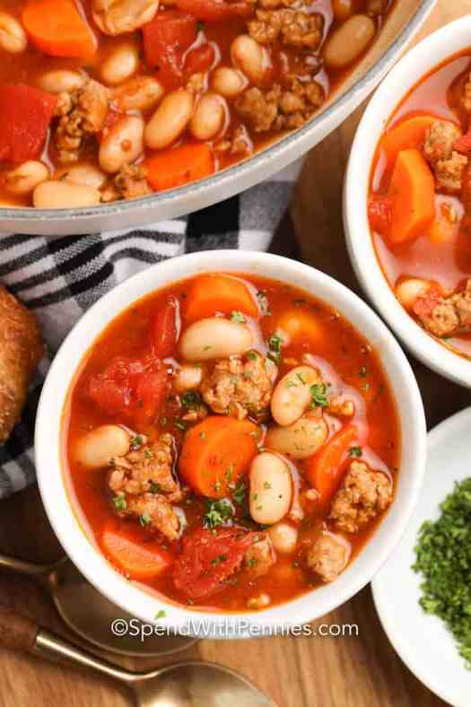 Italian Bean Soup in white bowls garnished with parsley.