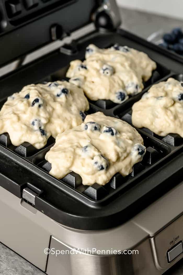 Blueberry Waffles batter in a waffle maker