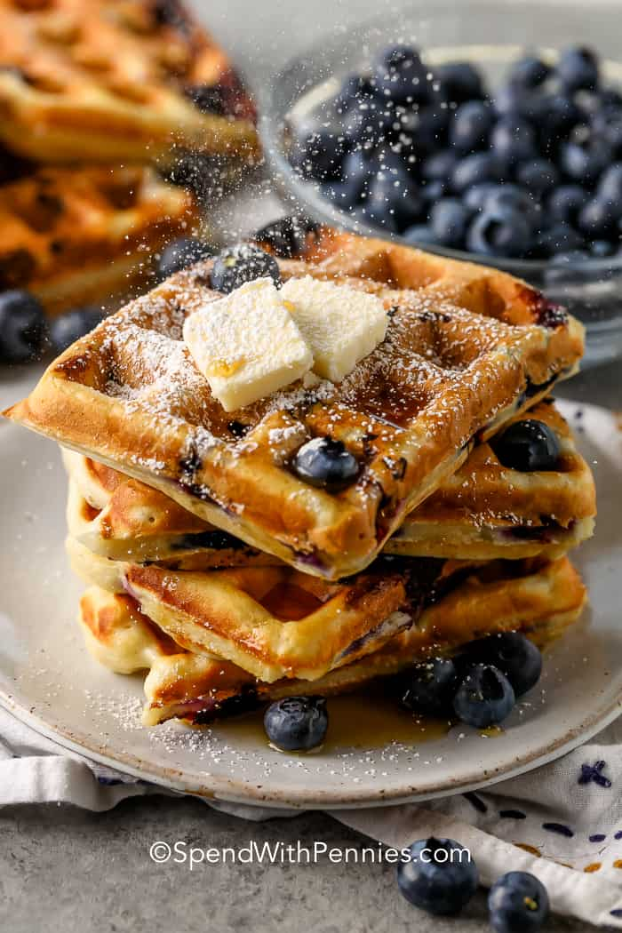 Blueberry Waffles on a plate with squares of butter
