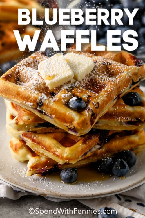 stack of Blueberry Waffles on a plate with syrup and a title