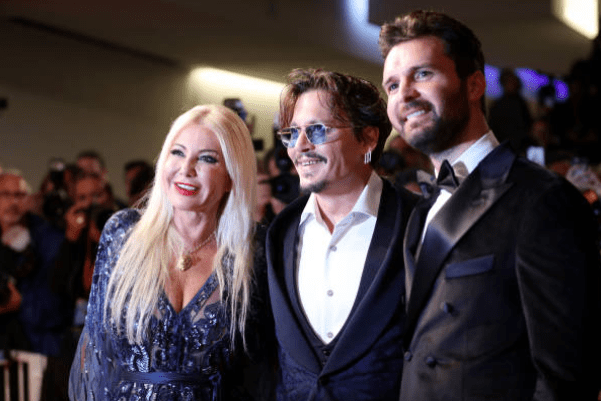 venezia-76-red-carpet-waiting-for-the-barbarians-johnny-deep-andrea-iervolino-monika-bacardi