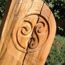 Celtic triskele carved in chestnut
