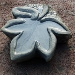 "Carved stone ""maple leaf"" bird bath"