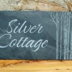 Carved slate house sign