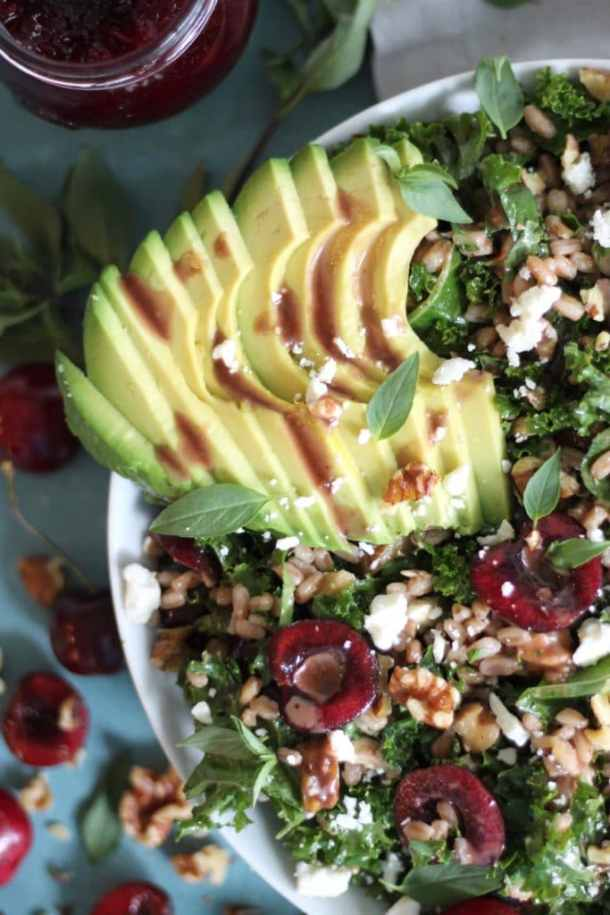 Cherry Kale Salad with Farro, Avocado, Feta, and Cherry Balsamic Vinaigrette