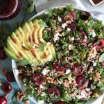 Cherry Kale Salad with Farro, Avocado, Feta, and Cherry Balsamic Vinaigrette