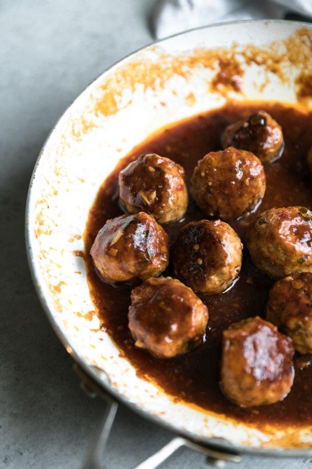 Close up shot of chili garlic sesame glazed pork meatballs