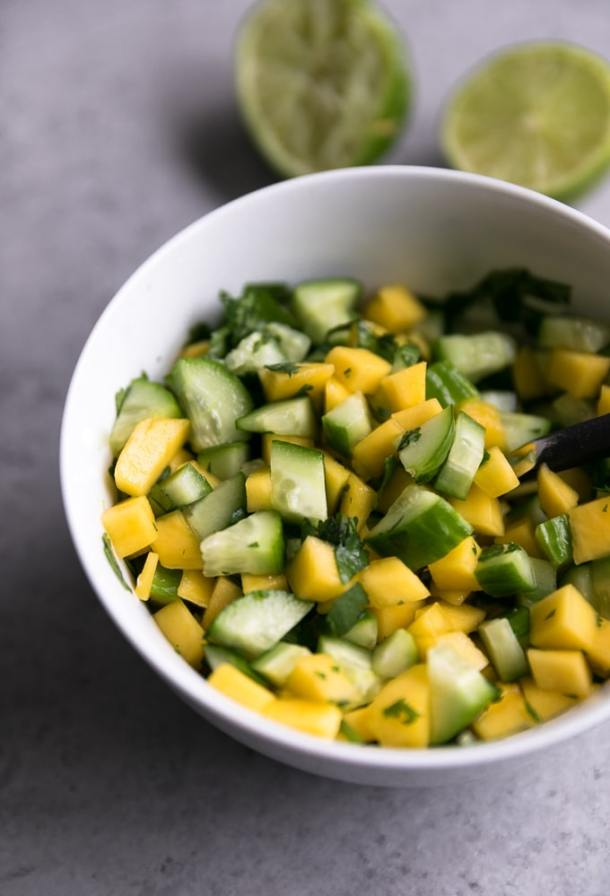 Close up shot of a bowl of mango cucumber salsa