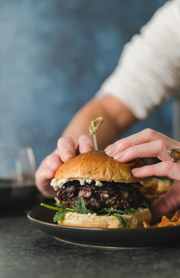 Close up shot of hands about to pick up a burger