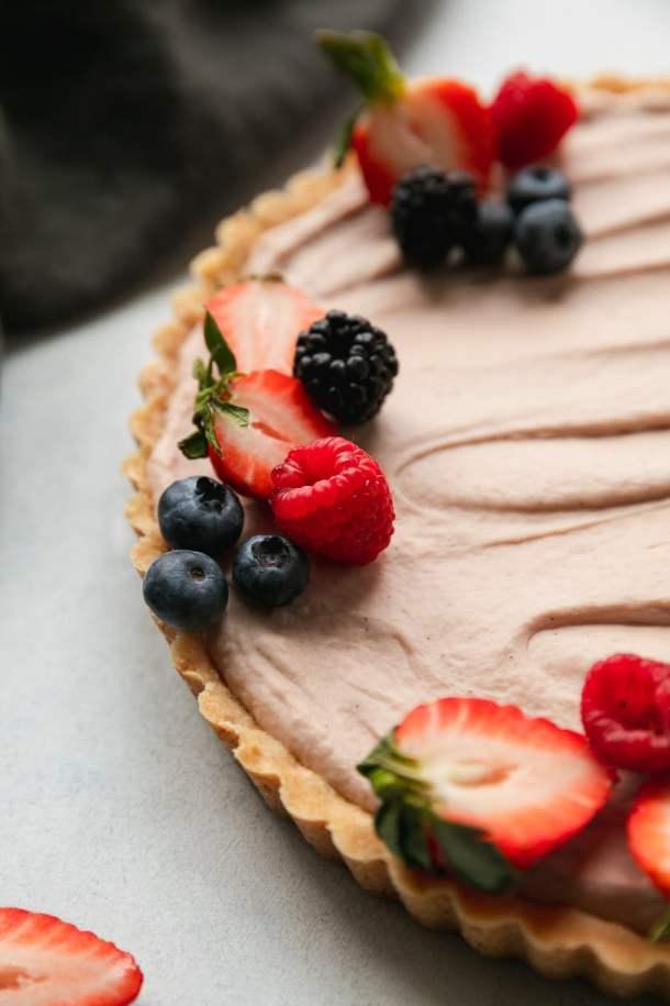 Close up shot of a berry cheesecake tart