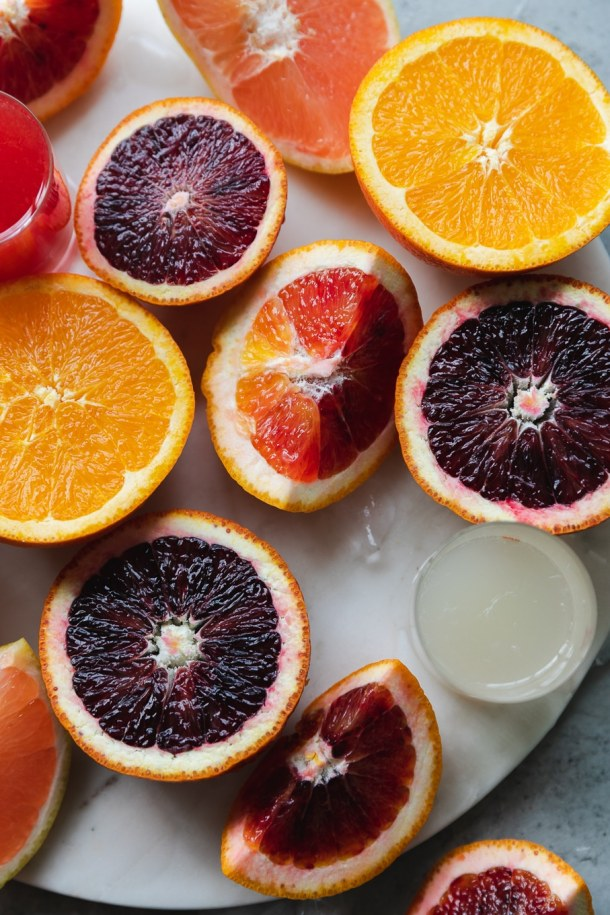 Close up shot of super colorful halved blood oranges and tangelos