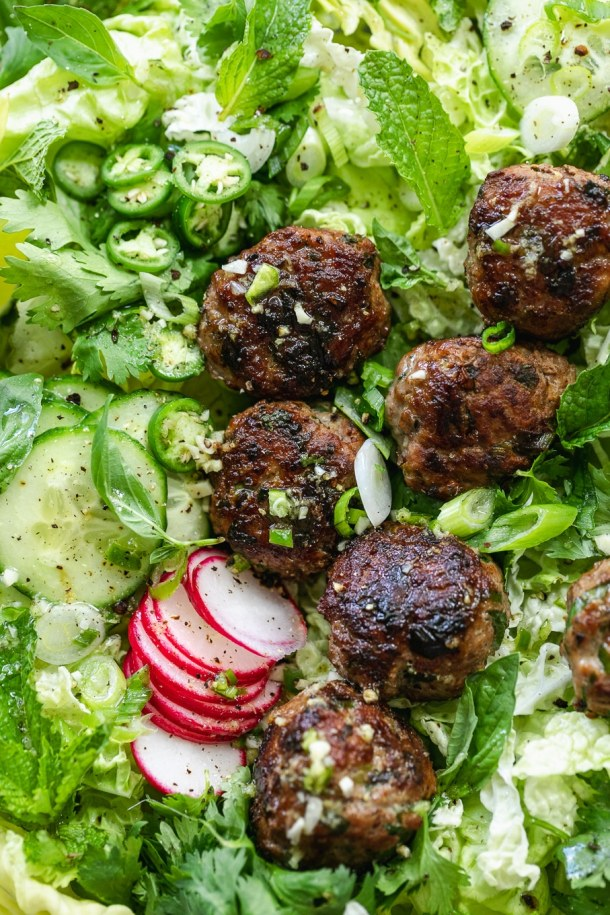 Overhead super close up shot of a vietnamese salad with pork meatballs