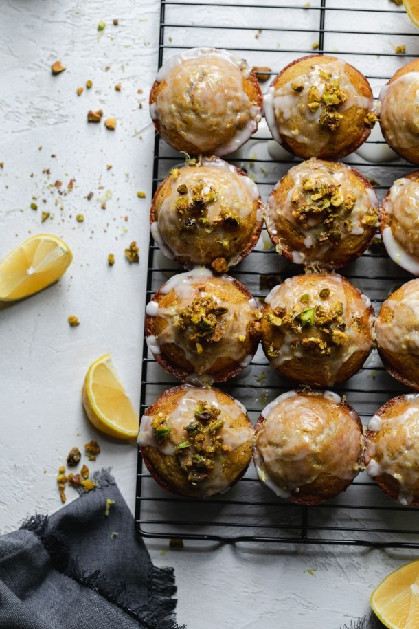Overhead shot of lemon pistachio muffins on a cooking rack