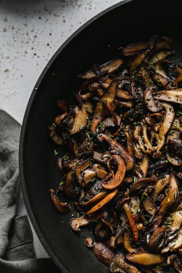 Overhead close up shot of a skillet filled with crispy wild mushrooms