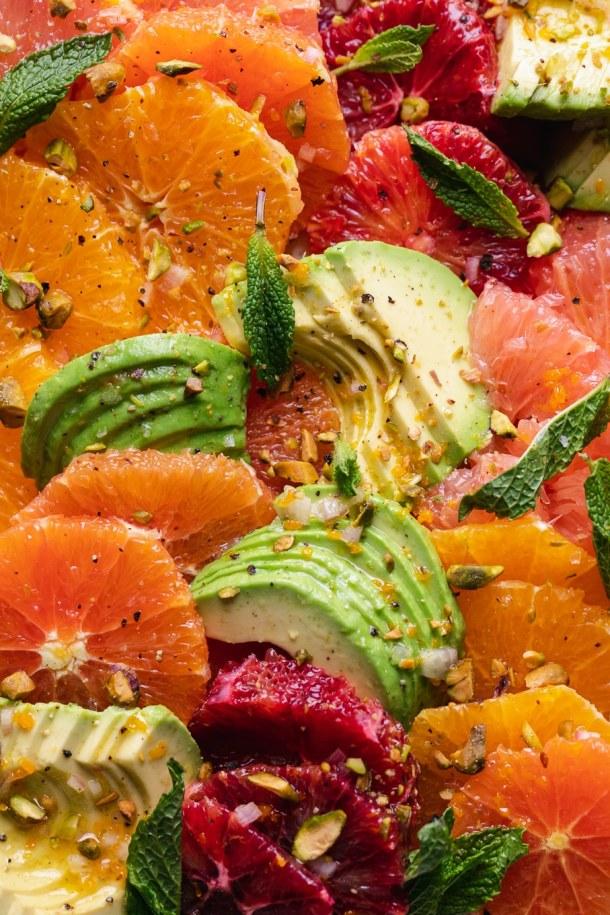 Super close up shot of sliced oranges and avocado