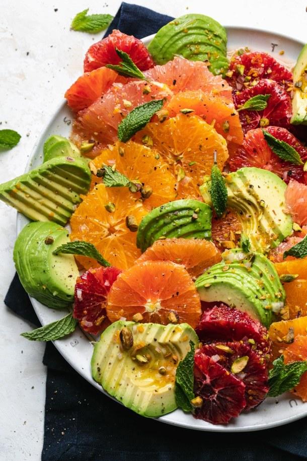 Overhead close up shot of a colorful citrus avocado salad