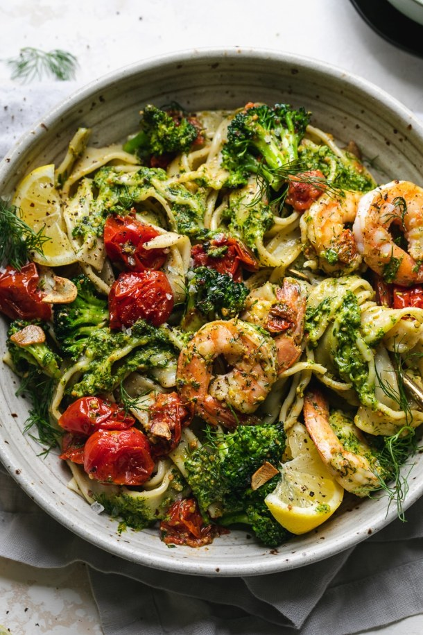 Overhead shot of a bowl of colorful pasta with tomatoes and broccoli