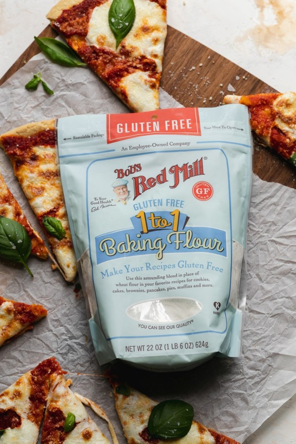 Overhead shot of a bag of flour surrounded by slices of pizza