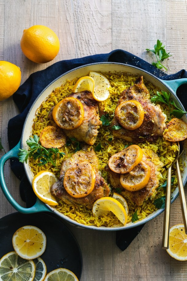 Overhead shot of a pan filled with meyer lemon chicken and golden rice