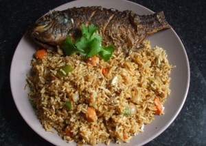 fried rice [with egg and vegetables] and fried tilapia