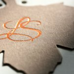 Die cut wedding invitation with copper hot foil