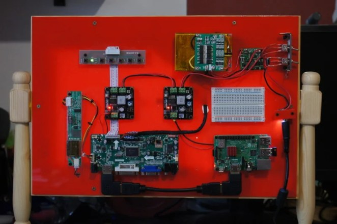 The rear is an exposed collection of controller board and, of course, the project's Raspberry Pi 3B+