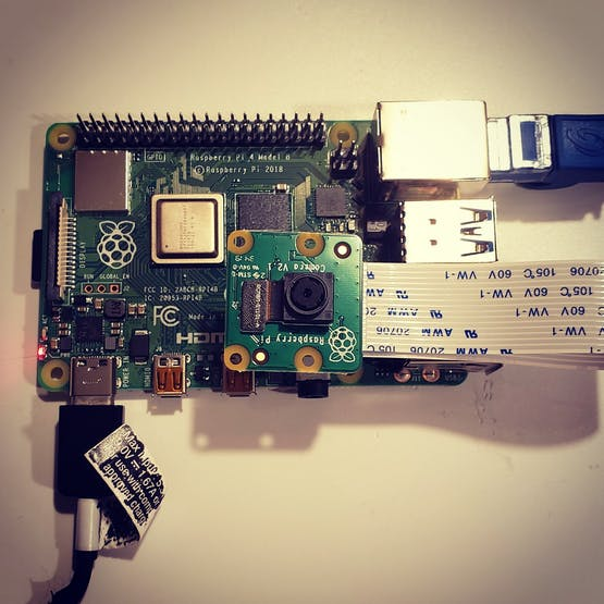 Birds eye view of Raspberry Pi 4 with a camera module connected