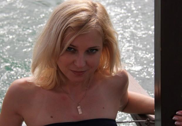 Natalia Poklonskaya in Strapless Dress near the water