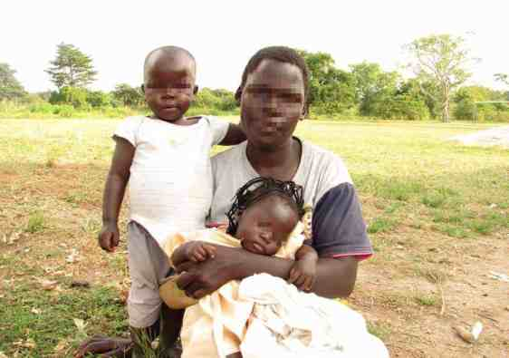 Ugandan Women with her daughters (blurred faces)