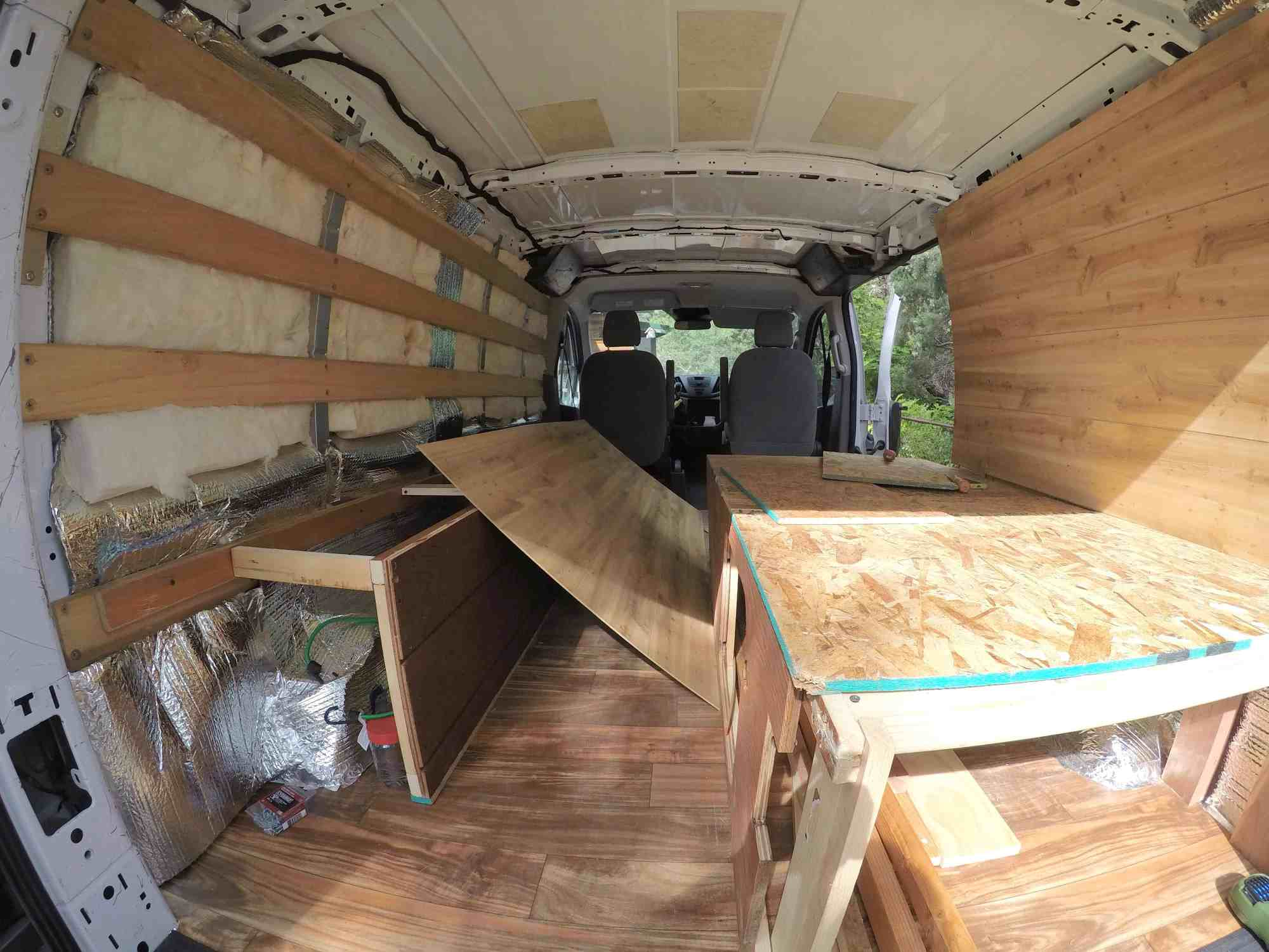 hight resolution of the chuck box is not a permanent fixture in the van which was a part of the design so after we created the bedframe and side storage unit