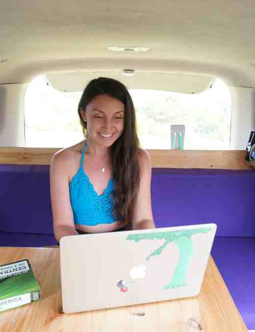 girl on laptop in camper van