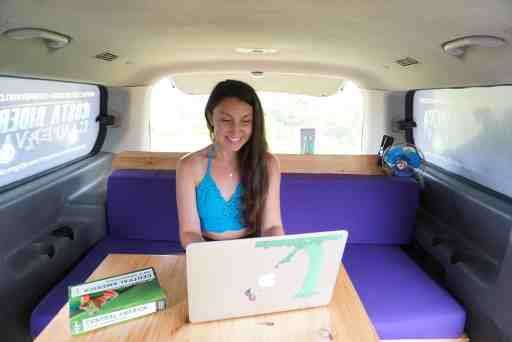 girl on laptop in camper van earning a remote income