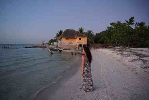 girl walking on beach in isla holbox