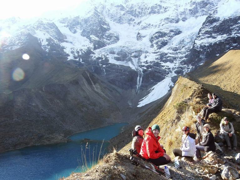 A group sitting infront of Salkantay Glacier Viewpoint