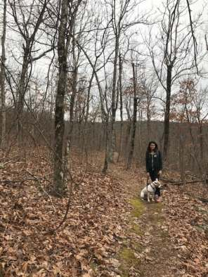 Girl and dog in the Ozarks