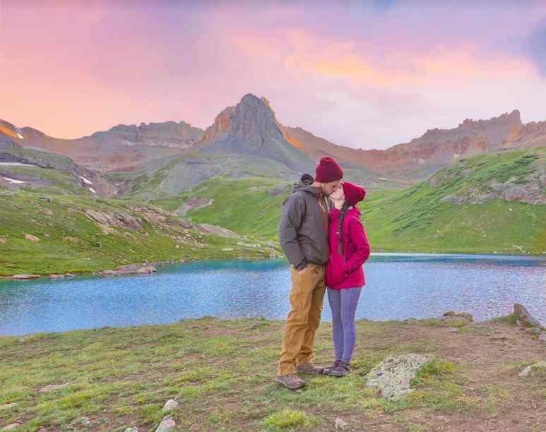 couple kisses at ice lake basin at sunset 2020 reflections