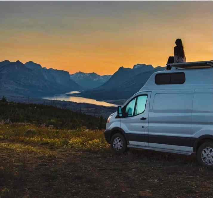 girl camping on van in Blackfeet Nation near Glacier National Park