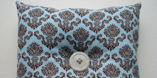 Blue pillow with button, photo by Nancy L. Stockdale