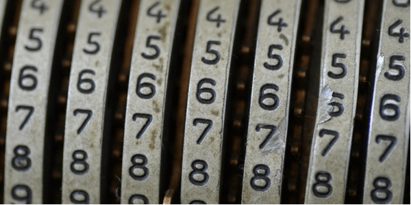 Numbers on a mechanical calculator, photo by e y e s e e