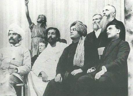 A picture of Swami Vivekananda sitting on stage at the Parliament of Religions in Chicago, in 1893.