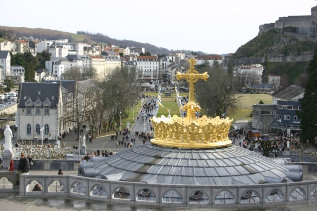 Church in Lourdes topped with gold cross