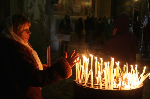 woman with candles in church