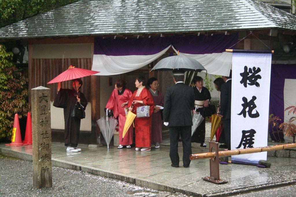 Geisha in Japan with umbrellas