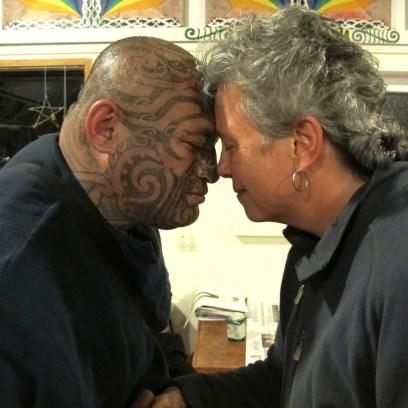 Maori greeting with man with tattoos