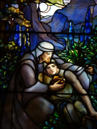 stained glass window of the Good Samaritan